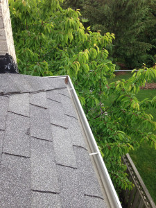 View from top of Toronto home looking inside of gutter after eavestrough cleaning service