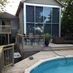 Completed window cleaning service on large two-storey windows at rear of home in Toronto
