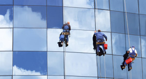 commercial window cleaners at work on high rise