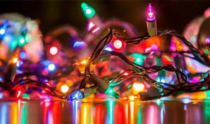 christmas lights sitting on a table being tested before installation in a Toronto home