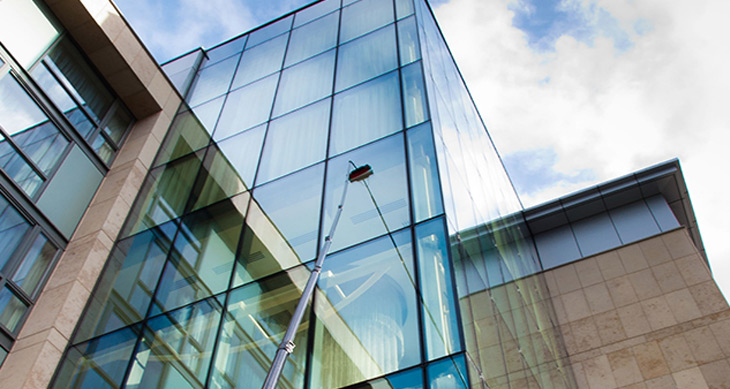 commercial window cleaning services being performed on an office building in mississauga