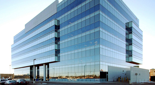 office building in oakville, sparkling clean windows are clearly visible as a result of the window cleaning service