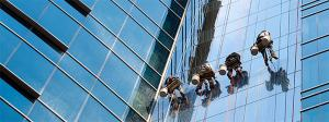 high-rise window cleaners working on an office building