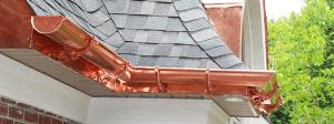 copper eavestroughing see on the exterior of a home