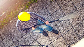 mississauga power washing worker cleaning a patio as viewed from above