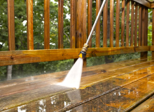 mississauga power washing services taking place, a pressure washing wand is clearly visible cleaning a deck