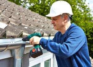 oakville eavestrough repair worker conducting full repairs on a home