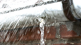 scarborough gutter with a massive leak, water is visibly pouring through the eavestrough