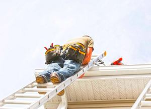 scarborough eavestrough repair worker on a ladder fixing the downspout on a home