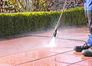 vaughan power washing services being carried out by a NICK'S Window Cleaning employee. a clean sparkling driveway is clearly visible
