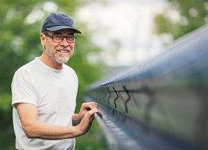 woodbridge eavestrough repair service worker showing off completed workmanship