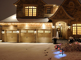 Oakville home looking fabulous with snow on the ground after receiving lighting installation services