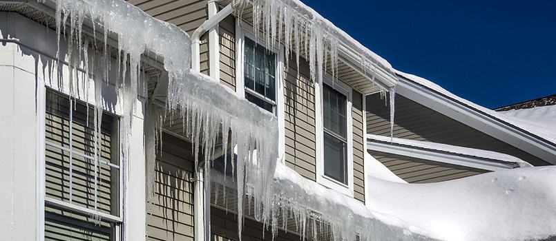 toronto home with frozen and clogged eavestrough problem